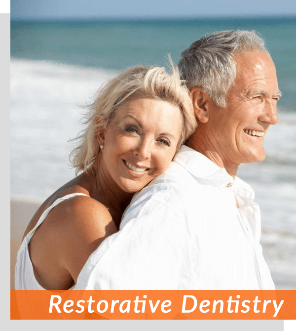 restorative dental patients taking photo together on santa monica beach